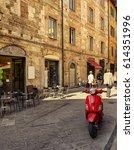 narrow cozy street in pisa ... | Shutterstock . vector #614351996