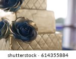gold and blue wedding cake | Shutterstock . vector #614355884