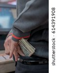 Small photo of Detail of employee stealing money