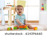 baby boy playing wooden toys at ... | Shutterstock . vector #614396660