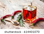 jar with oil and chili on... | Shutterstock . vector #614401070