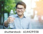 young man drinking water from...   Shutterstock . vector #614429558