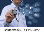 doctor holding stethoscope with ... | Shutterstock . vector #614430890