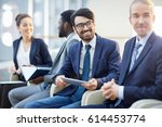 happy businessman listening to... | Shutterstock . vector #614453774