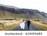 happy married couple running... | Shutterstock . vector #614454683