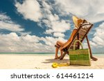 woman on a tropical beach with... | Shutterstock . vector #614461214