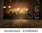 empty wooden table in front of... | Shutterstock . vector #614483663