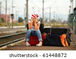 young girl sitting on bag and... | Shutterstock . vector #61448872