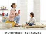 cute little boy at speech... | Shutterstock . vector #614515253