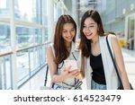 two young girls go shopping... | Shutterstock . vector #614523479