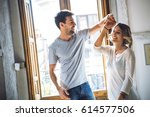 lovely young couple smiling and ... | Shutterstock . vector #614577506