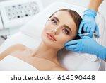 beauty salon  doctor's hands in ... | Shutterstock . vector #614590448