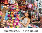 asian young woman traveling and ... | Shutterstock . vector #614610833