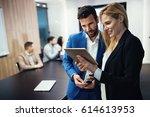 business colleagues having... | Shutterstock . vector #614613953