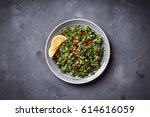 tabbouleh salad on plate ... | Shutterstock . vector #614616059