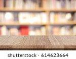 empty wooden table over blur... | Shutterstock . vector #614623664