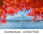 Stock photo mt fuji autumn in the early morning with reflection on the lake kawaguchiko 614627318