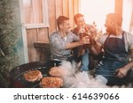 happy young friends making... | Shutterstock . vector #614639066