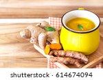 cup of turmeric tea with lemon ... | Shutterstock . vector #614674094