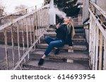 teenager girl vaping outdoor... | Shutterstock . vector #614693954