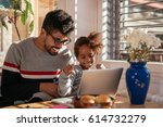 photo of an american father and ... | Shutterstock . vector #614732279