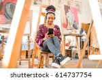portrait of a young african... | Shutterstock . vector #614737754