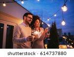 happy couple enjoying drinks... | Shutterstock . vector #614737880