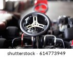 photo of go kart steering wheel | Shutterstock . vector #614773949