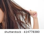 combing with brush and pulls... | Shutterstock . vector #614778380