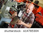 craftsman stitching shoes on... | Shutterstock . vector #614785304