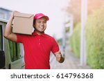 smiling young male postal... | Shutterstock . vector #614796368