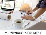 interior designer discussing... | Shutterstock . vector #614843144