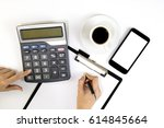 female accountant or banker... | Shutterstock . vector #614845664