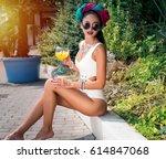 enjoying her summer vacation.... | Shutterstock . vector #614847068