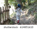 happy little girl walking on... | Shutterstock . vector #614851610
