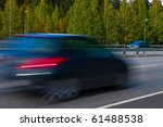 Motion blur picture of fast small modern car on highway - stock photo