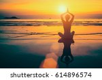 yoga woman meditation on sunset ... | Shutterstock . vector #614896574