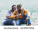 two black race friends having... | Shutterstock . vector #614907056