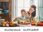 healthy food at home. happy... | Shutterstock . vector #614916809
