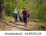 group of people walking by... | Shutterstock . vector #614925110