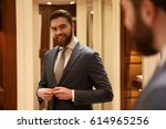 smiling man in suit looking at ... | Shutterstock . vector #614965256