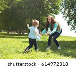happy family  mother with son... | Shutterstock . vector #614972318