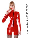 Small photo of Fashion Funny Babyface Girl Wearing Red Party PVC Catsuit and fishnet pantyhose, playing with tasty watermellon candy