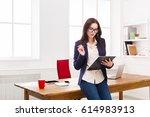 serious ceo businesswoman in... | Shutterstock . vector #614983913