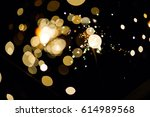 glowing sparks in the dark | Shutterstock . vector #614989568