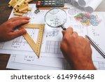 man architect draws a plan ... | Shutterstock . vector #614996648