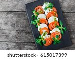 caprese salad with mozzarella... | Shutterstock . vector #615017399