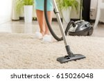 woman cleaning room with vacuum ... | Shutterstock . vector #615026048