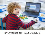 boy in robotics school makes... | Shutterstock . vector #615062378