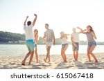 happy smiling friends enjoying... | Shutterstock . vector #615067418